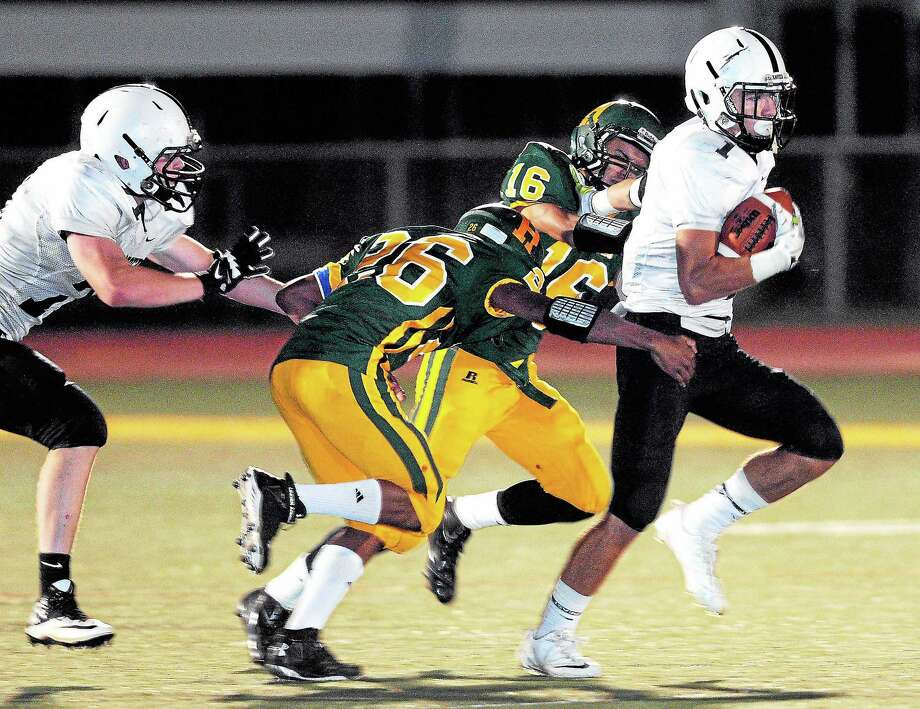 (Arnold Gold — New Haven Register)  Andrew Meoli of Xavier breaks out for long yardage at the start of the second half against Hamden on 9/27/2013. Photo: Journal Register Co.