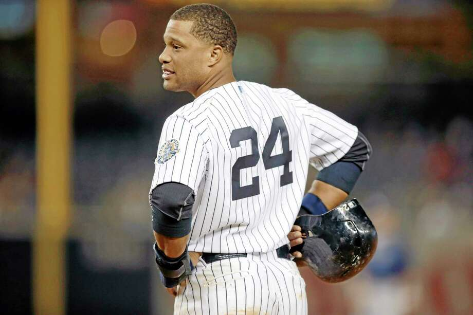The Yankees' Robinson Cano looks toward the dugout during the eighth inning of New York's 8-3 loss to the visiting Tampa Bay Rays on Wednesday. Rumors began to swirl this week that Cano was seeking a 10-year, $305 million contract in free agency. As Register sports columnist Chip Malafronte points out, you can get a lot for $305 million. Photo: Kathy Willens — The Associated Press  / AP