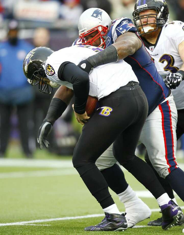 ASSOCIATED PRESS New England Patriots defensive end Vince Wilfork (75) sacks Baltimore Ravens quarterback Joe Flacco (5) during the AFC championship game on Jan. 22 at Gillette Stadium in Foxborough, Mass. Wilfork is not easy to move out of the middle of the Patriots' defense.