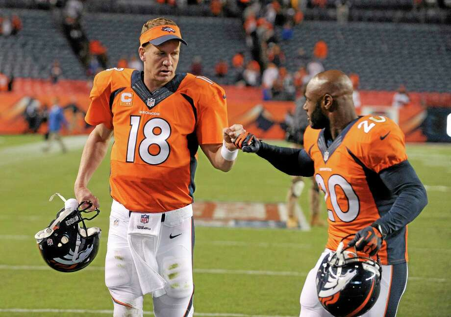 Peyton Manning, left, Mike Adams and the Denver Broncos are 3-0 and remain the No. 1 team in the Register NFL Rankings this week. Photo: Jack Dempsey — The Associated Press  / FR42408 AP