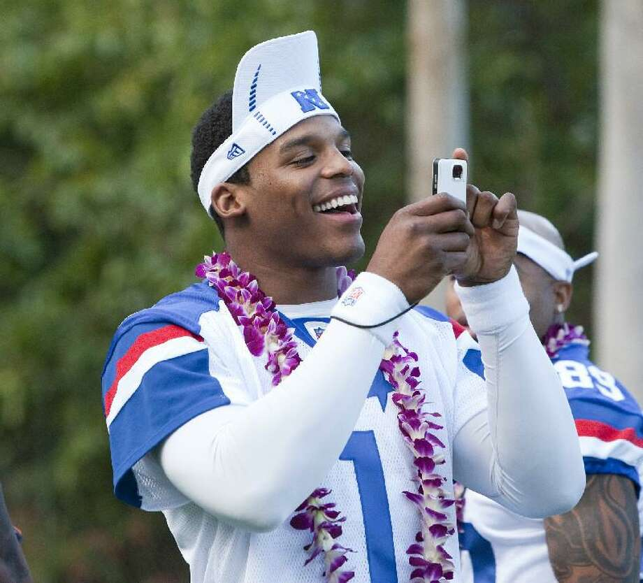 ASSOCIATED PRESS Carolina Panthers quarterback Cam Newton (1) of the NFC takes pictures before practice Friday in Kapolei, Hawaii, for the Pro Bowl game scheduled for Jan. 29.
