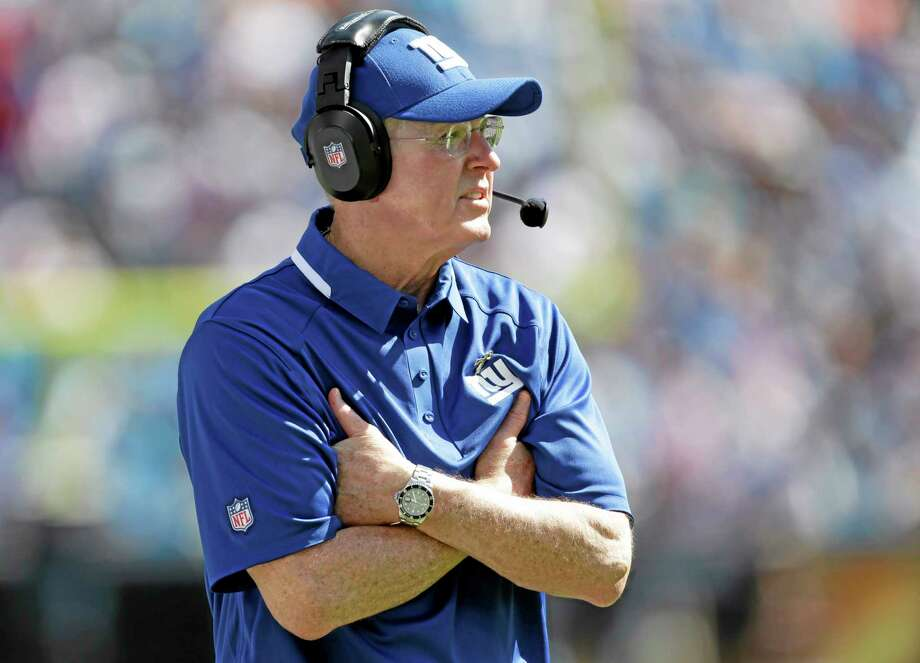 Coach Tom Coughlin will square off against Andy Reid for the 20th time in his career when the Giants face the Chiefs on Sunday. Photo: Bob Leverone — The Associated Press  / FR170480 AP