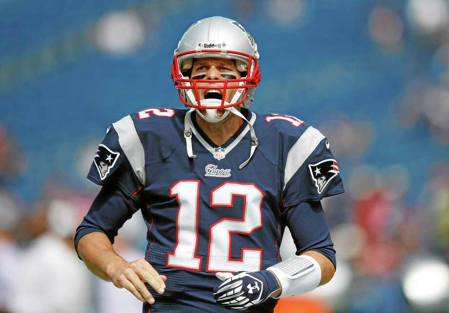 Quarterback Tom Brady and the Patriots will try to stay unbeaten when they take on the Falcons on Sunday. Photo: Elise Amendola — The Associated Press  / AP