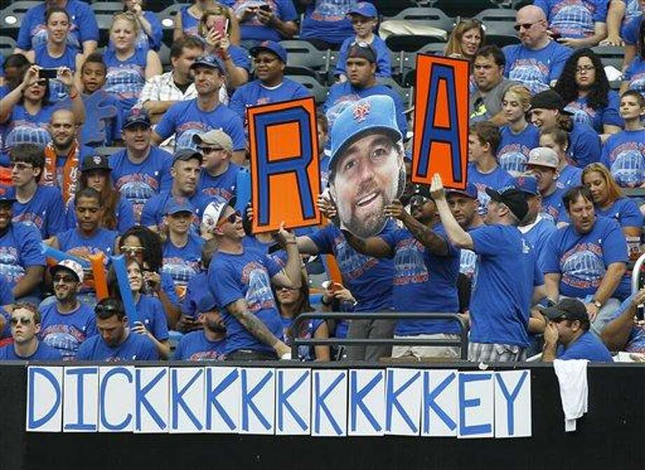 Fans pay tribute to New York Mets pitcher R.A Dickey, who is going for his 20th victory, during a baseball game against the Pittsburgh Pirates at Citi Field in New York, Thursday, Sept. 27, 2012. (AP Photo/Kathy Willens) Photo: AP / AP