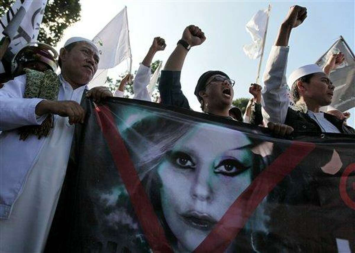 Muslim men shout slogans during a rally May 25 against singer Lady Gaga's concert that is scheduled to be held June 3, outside the U.S. Embassy in Jakarta, Indonesia. Lady Gaga canceled her show Sunday. Associated Press