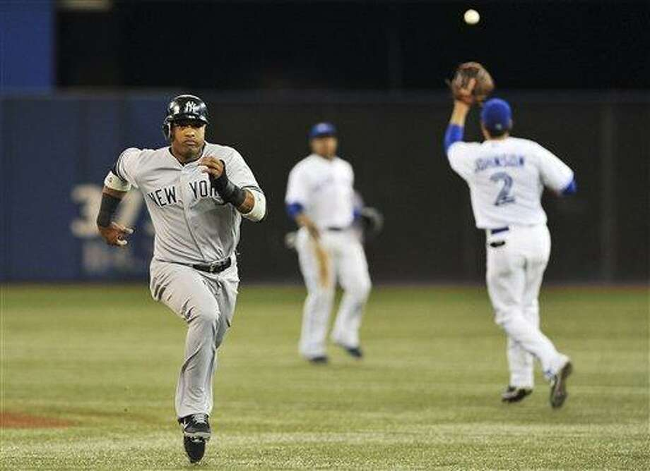 New York Yankees' Robinson Cano fails to make it back to first after running on a pop out by Nick Swisher against the Toronto Blue Jays during the fourth inning of a baseball game in Toronto, Thursday, Sept. 27, 2012. (AP Photo/The Canadian Press, Aaron Vincent Elkaim) Photo: AP / The Canadian Press