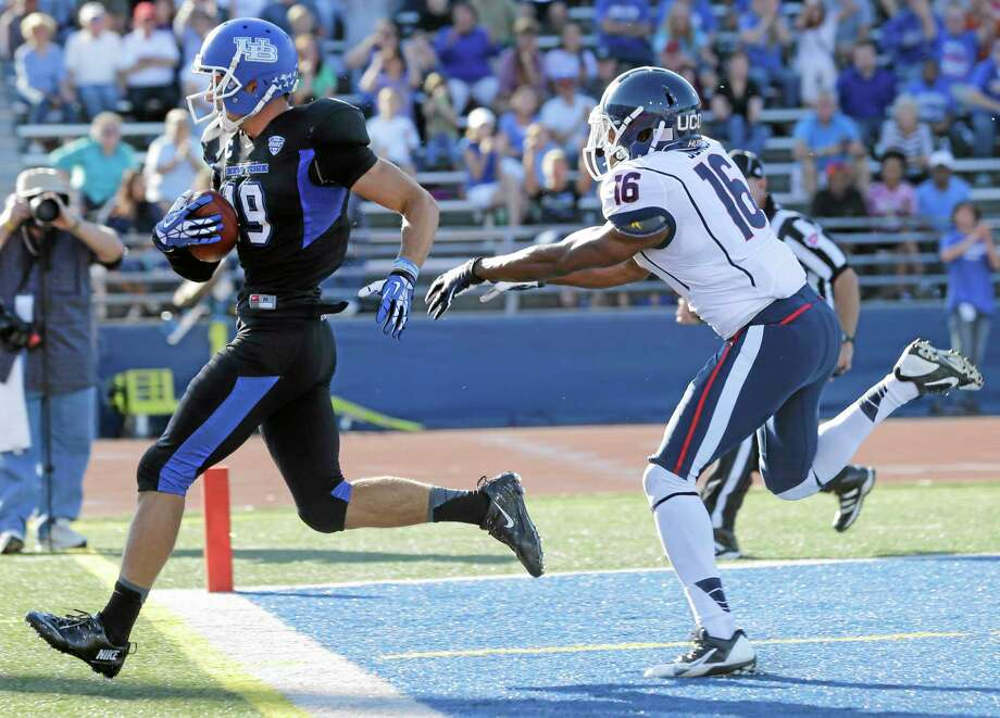 Buffalo wide receiver Alex Neutz (19) scores on a touchdown after a reception in front of UConn cornerback Byron Jones during the first half Saturday. Photo: Mike Groll — The Associated Press  / AP