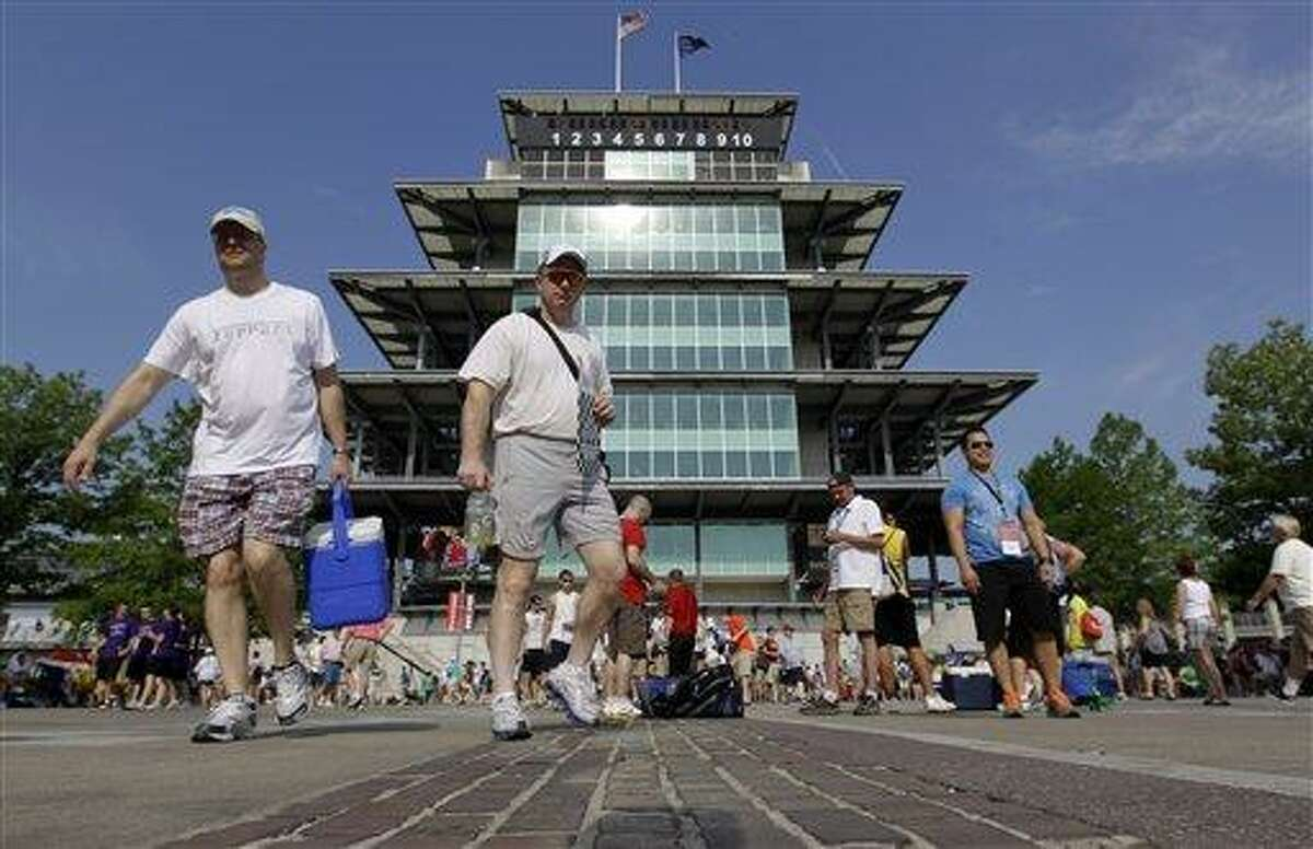 Race fans cross the yard of bricks in front of the Pagoda on their way to their seats before the running of the 96th Indianapolis 500 auto race Sunday at the Indianapolis Motor Speedway in Indianapolis. Associated Press