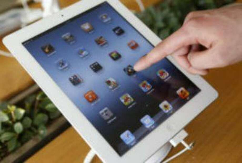 Tablet computers are expected to outsell PCs for the first time this year, according to a new report. Photo: REUTERS / X01385