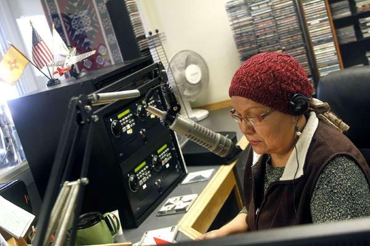 """Jon Austria/The Daily Times KNDN AM 960's Dedra """"Dee"""" Wheeler talks on the air on Thursday."""