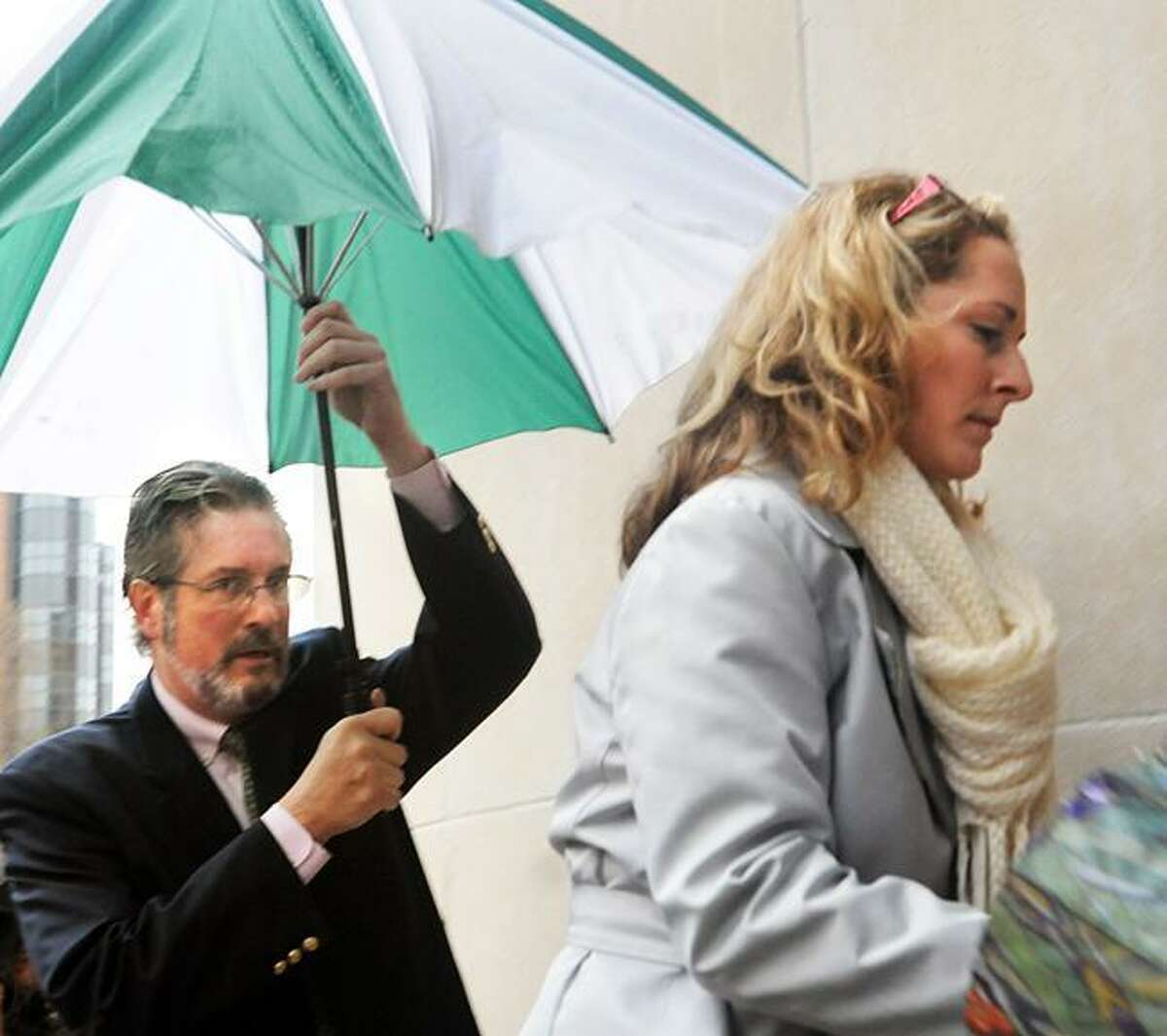 New Haven- Dr. William Petit (L) and his fiance arrive at Superior Court. Melanie Stengel/Register
