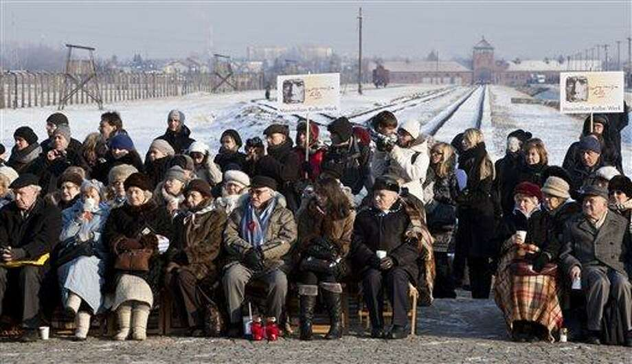 Holocaust survivors attend a ceremony at the Auschwitz-Birkenau Nazi death camp on the 67th anniversary of the camp's liberation, in Oswiecim, Poland, Friday.  Survivors and others gather every year to commemorate those who perished on the anniversary of the camp's liberation by the Soviet Red Army on Jan. 27, 1945.  Associated Press Photo: AP / AP