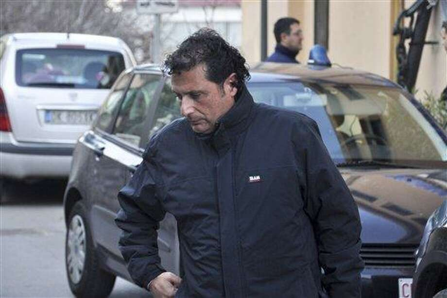 In this Jan. 14, 2012, photo, Francesco Schettino, captain of the luxury cruiser Costa Concordia, which ran aground off the small Italian island of Isola del Giglio, is arrested in Porto Santo Stefano, Italy. Schettino is under house arrest, facing possible charges of manslaughter, causing a shipwreck and abandoning his ship.  Associated Press Photo: ASSOCIATED PRESS / AP2012