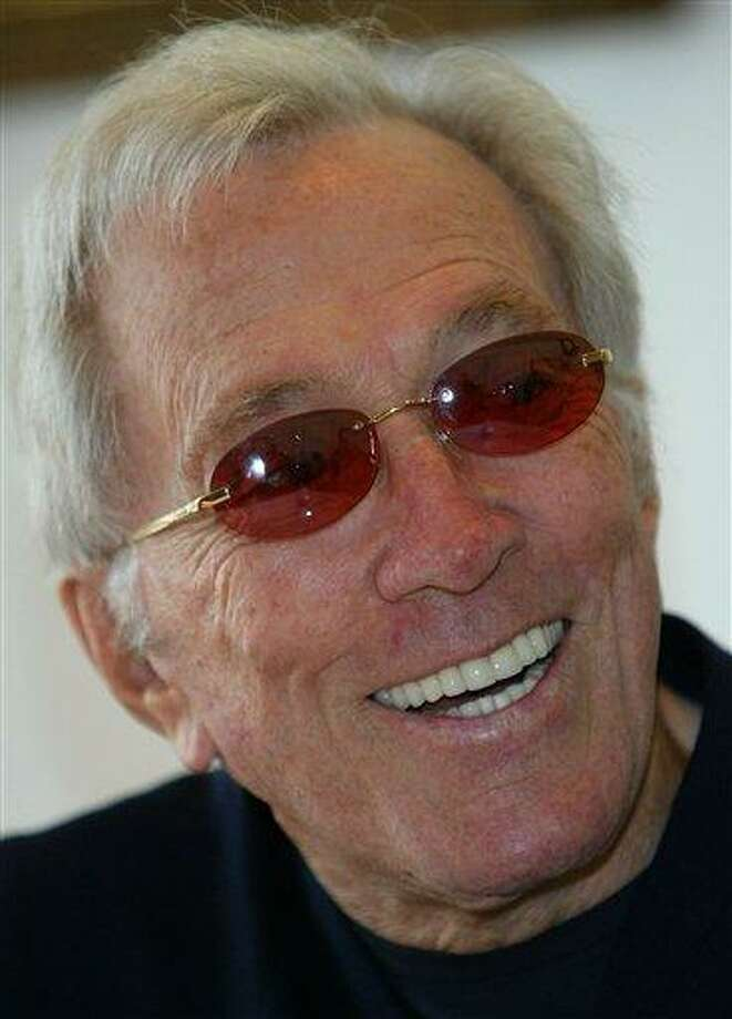 """FILE - In this July 25, 2004 file photo, U.S. singer Andy Williams smiles as he speaks to reporters during his news conference at a Tokyo hotel. Emmy-winning TV host and """"Moon River"""" crooner Williams died Tuesday night, Sept, 25, 2012 at his home in Branson, Mo., following a year-long battle with bladder cancer. He was 84. (AP Photo/Shizuo Kambayashi, File) Photo: AP / AP"""