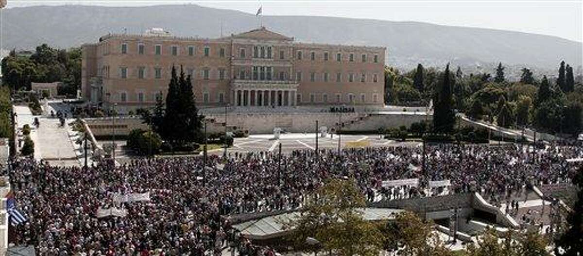Protesters of the Greek Communist party affiliated unions march Wednesday in front of the Greek Parliament in Athens. Associated Press
