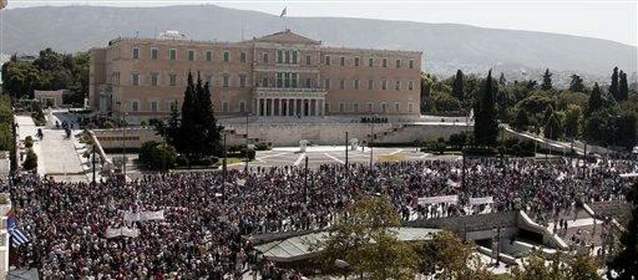 Protesters of the Greek Communist party affiliated unions march Wednesday in front of the Greek Parliament in Athens. Associated Press Photo: AP / AP