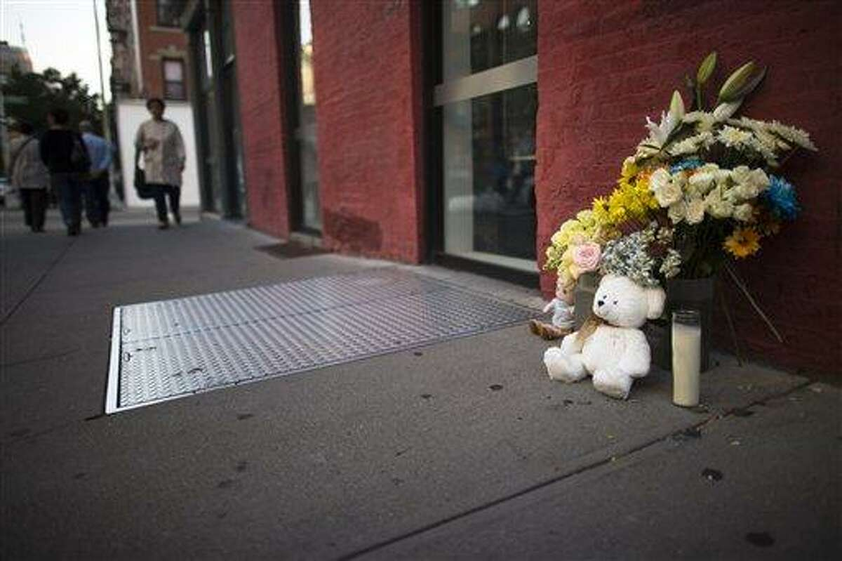 Supporters of the Etan Patz family leave flowers and stuffed toys Friday by the basement entrance to the former SoHo bodega, where it is believed Etan was murdered. Associated Press