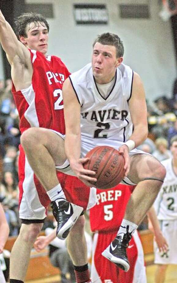 """Special to the Press 01.27.12 Xavier's Jovan Santos-Knox gets fouled by Fairfield Prep's Terry Tarpey in Friday's basketball game. Prep won, 67-65. To buy a glossy print of this photo and more, visit <a href=""""http://www.middletownpress.com"""">www.middletownpress.com</a>. / a"""