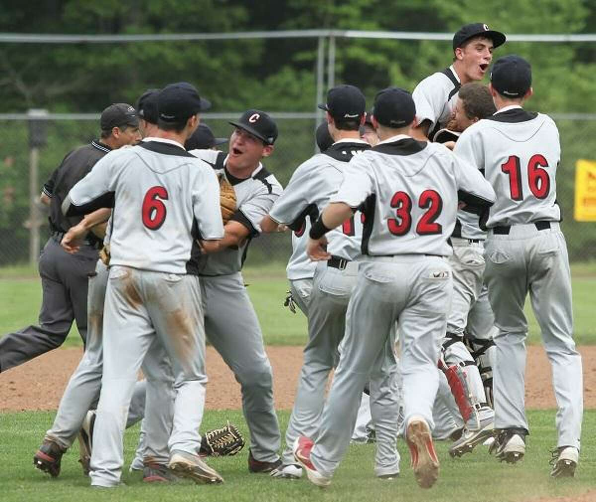 Special to the Press 05.26.12. The Cromwell baseball team celebrates its Shoreline League championship after a 3-2 victory over East Hampton. To buy a glossy print of this photo and more, visit www.middletownpress.com