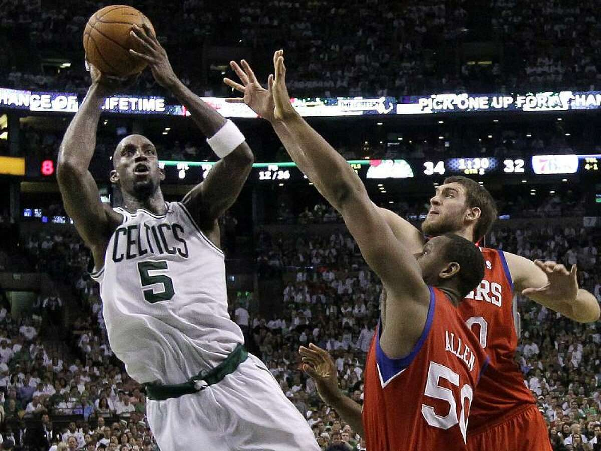ASSOCIATED PRESS Boston Celtics forward Kevin Garnett (5) shoots against Philadelphia 76ers forward Lavoy Allen (50) and center Spencer Hawes during the second quarter of Game 7 of their NBA Eastern Conference semifinal series on Saturday in Boston. The Celtics won 85-75.