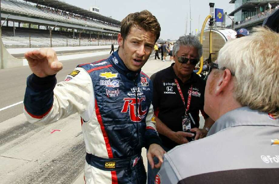 ASSOCIATED PRESS IndyCar driver Marco Andretti, left, talks with a member of his crew as his grandfather and 1969 Indy 500 champion Mario Andretti, center, looks on following the final day of practice for the Indianapolis 500 auto race at the Indianapolis Motor Speedway in Indianapolis Friday. The 96th running of the race is Sunday.