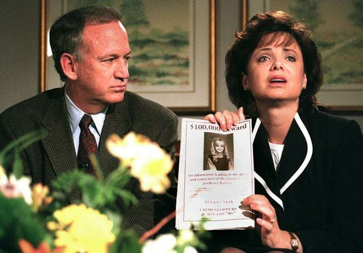 John Ramsey looks on as his wife, Patsy, holds an advertisement promising a reward for information leading to the arrest and conviction of the killer of their 6-year-old daughter, JonBenet, during an interview with reporters on May 1, 1997, in Boulder. Thirteen years after the conclusion of the grand jury investigation into JonBenet s death, sources have confirmed to the Daily Camera that the jurors voted to indict the Ramseys on charges of child abuse resulting in death but then-District Attorney Alex Hunter refused to prosecute the case. (Camera file photo)