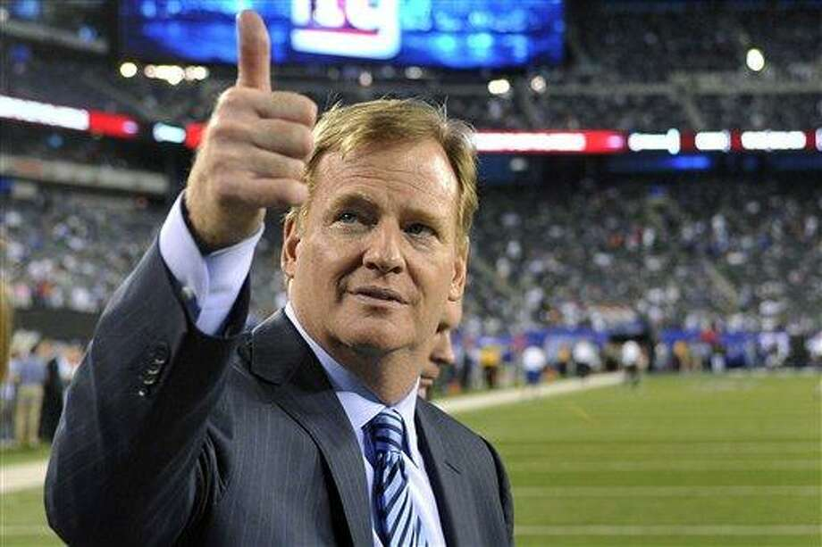 FILE - In this Sept. 5, 2012, file photo, Commissioner Roger Goodell gestures to fans before an NFL football game between the New York Giants and the Dallas Cowboys in East Rutherford, N.J. The NFL and referees' union reached a tentative agreement on Wednesday, Sept. 26, to end a three-month lockout that triggered a wave of frustration and anger over replacement officials and threatened to disrupt the rest of the season. (AP Photo/Bill Kostroun, File) Photo: ASSOCIATED PRESS / The Associated Press2012
