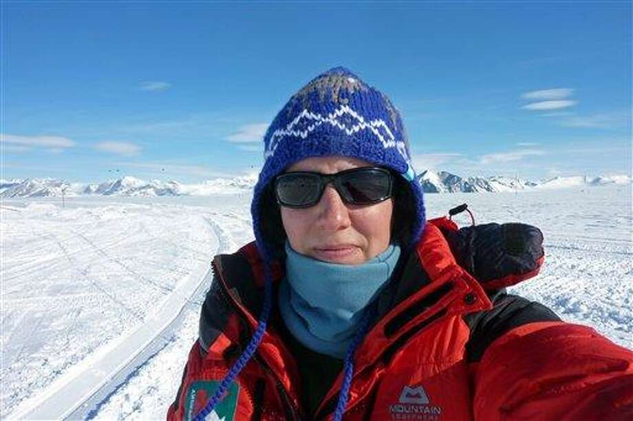 In this Nov. 19, 2011, file photo provided by the Kaspersky ONE Trans-antarctic Expedition, Felicity Aston takes a picture of herself at Union Glacier days before she traveled to her starting point on the Ross Ice Shelf for a solo trek across Antarctica. Aston, 34, crossed Antarctica in 59 days, pulling two sleds for more than 1,084 miles (1,744 kilometers) from the Leverett Glacier to the Hercules Inlet on the Ronne Ice Shelf. On Jan. 23, 2012,  she tweeted that she has completed her journey.  Associated Press Photo: ASSOCIATED PRESS / AP2010