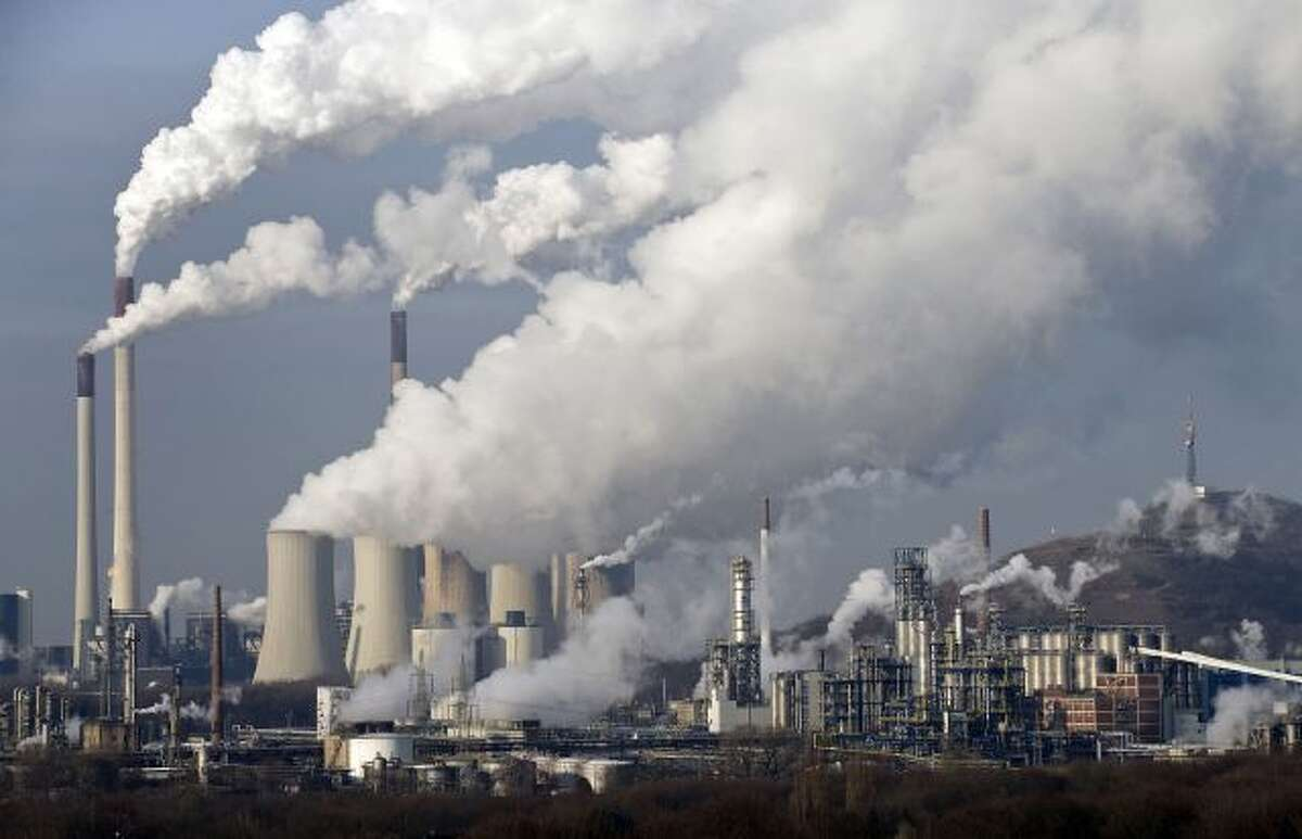FILE - In this Dec. 16, 2009 file photo, steam and smoke rises from a coal power station in Gelsenkirchen, Germany. Scientists are more confident than ever that pumping carbon dioxide into the air by burning fossil fuels is warming the planet. By how much is something governments and scientists meeting in Stockholm will try to pin down with as much precision as possible Friday Sept. 27, 2013 in a seminal report on global warming. (AP Photo/Martin Meissner, File)
