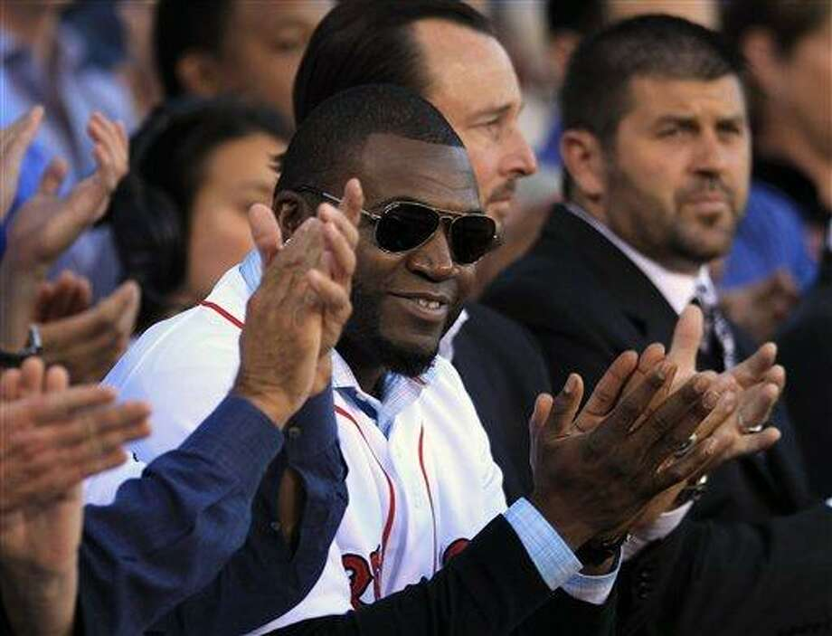 Boston Red Sox's David Ortiz, center front, applauds with former Red Sox players Tim Wakefield, center right, and Jason Varitek, right, during ceremonies held to honor the life of the late Johnny Pesky at Fenway Park, in Boston, Sunday, Sept. 23, 2012.  Pesky, who died in August at the age of 92, was a player, manager, and coach for the team. (AP Photo/Steven Senne) Photo: AP / AP