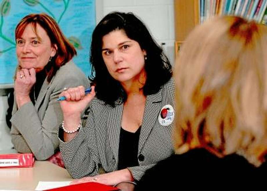 Catherine Avalone/The Middletown Press State Sen. Dante' Bartolomeo-13th District, a member of the Bipartisan Task Force on Gun Violence Prevention and Children's Safety met with Middetown Superintendent of Schools, Dr. Pat Charles, at left, as well as educators, parents, board of education members and public safety officials at a meeting at Farm Hill School to discuss the safety of schools and options for improving school security.