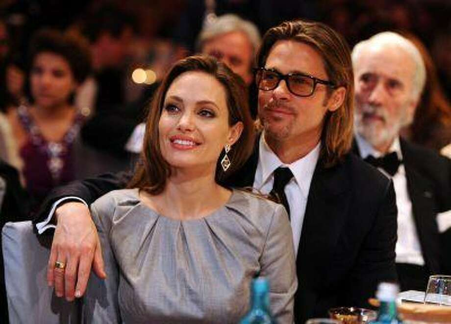 "Angelina Jolie and Brad Pitt attend the ""Cinema for Peace 2012"" charity gala during the 62nd Berlinale film festival in Berlin February 13, 2012. REUTERS/Andreas Rentz/Pool / X80003"