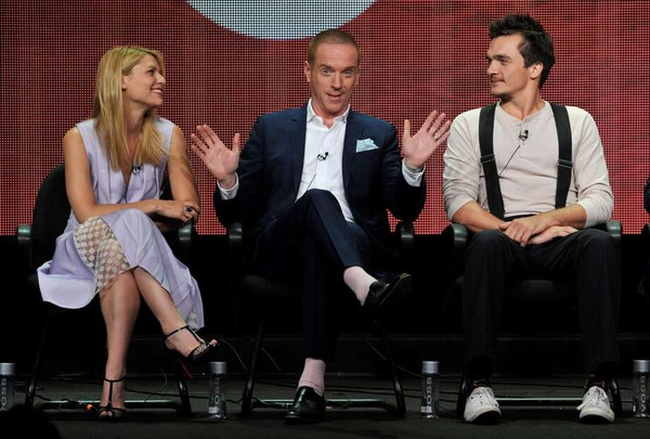 """From left, Claire Danes, Damian Lewis and Rupert Friend participate in the """"Homeland"""" panel at the Showtime Summer TCA on Monday, July 29, 2013, at the Beverly Hilton hotel in Beverly Hills, Calif. (Photo by Chris Pizzello/Invision/AP) Photo: Chris Pizzello/Invision/AP / Invision net"""
