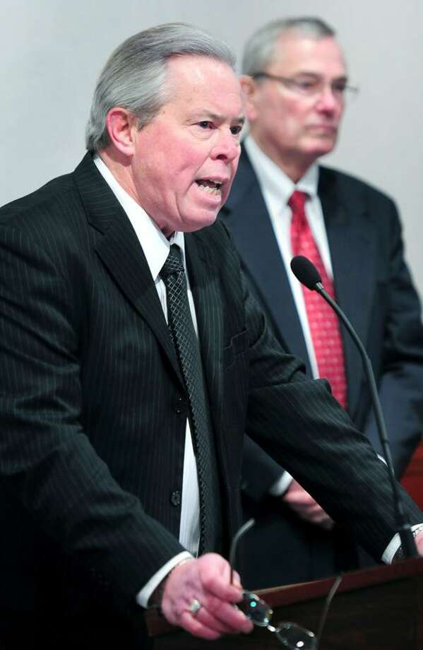 Connecticut Education Association Vice President Jeff Leake (left), speaks at a press conference prior to a legislative hearing about gun control at the Legislative Office Building in Hartford on 1/28/2013.Photo by Arnold Gold/New Haven Register