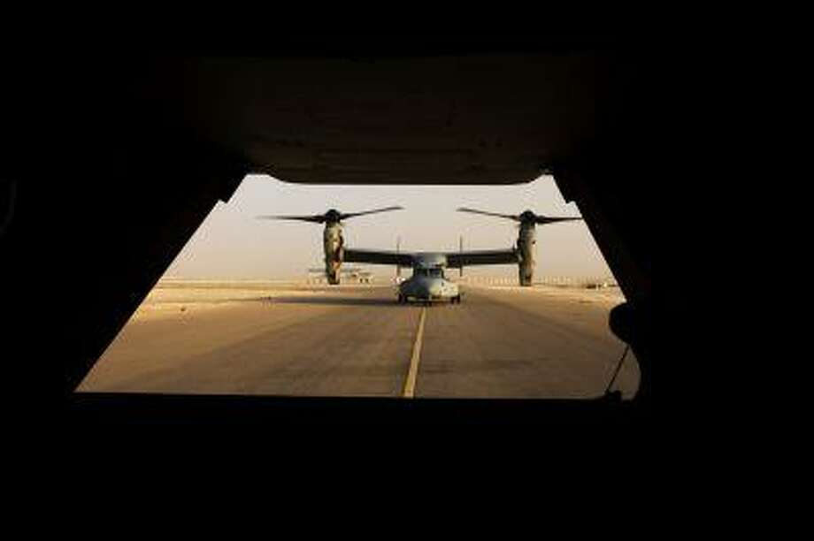 In this Oct. 14, 2008. file photograph , a V-22 Osprey tilt rotor aircraft taxies after a mission at Asad air base in the western Iraqi desert. Photo: ASSOCIATED PRESS / AP2010