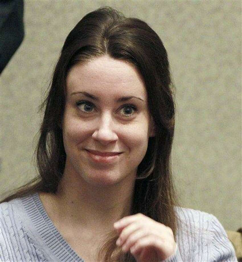Casey Anthony smiles before the start of her sentencing hearing in Orlando, Fla. Casey Anthony has filed for bankruptcy in Florida, claiming about $1,100 in assets and $792,000 in liabilities. AP Photo/Joe Burbank Photo: AP / POOL Orlando Sentinel
