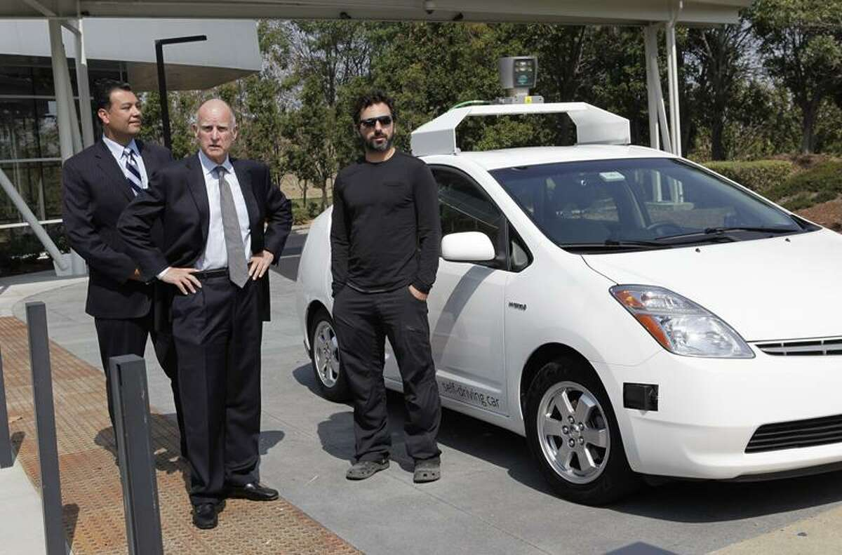 From left, Sen. Alex Padilla, Gov. Jerry Brown and Sergey Brin, Google co-founder, arrive in a driverless car before a signing ceremony for SB 1298 at Google Headquarters in Mountain View, Calif., on Tuesday. Senate Bill 1298 will allow driverless cars to be operated on public roads for testing purposes. (Gary Reyes/ Staff)