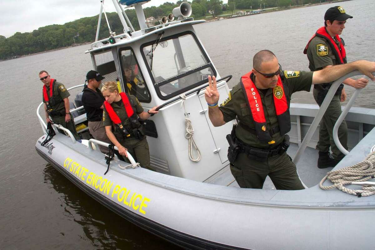 CT Connecticut Department of Energy and Environmental Protection Boating Administrator Eleanor Mariani secures a line to a dock on the Connecticut River in Old Saybrook while participating in a training class with Connecticut Environmental Conservation Police officers. Connecticut ENCON officers will be enforcing state boating under the influence laws during Operation Drywater 2012 and throughout the year. - Tony Bacewicz Photo