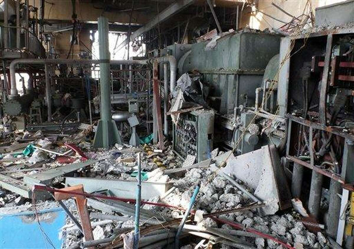 In this June 9, 2011 file photo released by Tokyo Electric Power Co., damaged equipments and piping on the fourth floor of the reactor building of the Unit 4, part of the cooling system at Fukushima Dai-ichi nuclear power plant in Okuma, Fukushima prefecture, northeastern Japan, are shown. The Japanese government's worst-case scenario at the height of the nuclear crisis last year had warned that a massive evacuation might be needed, including for Tokyo residents, according to a report obtained Monday. But officials kept silent, fearing widespread panic and are still trying to keep the report secret. Associated Press