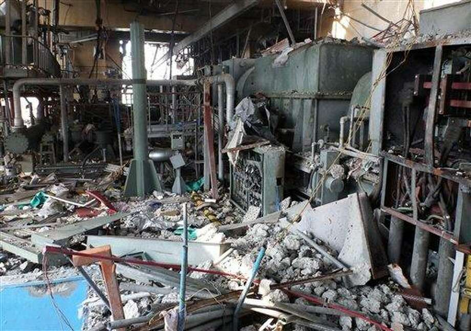 In this June 9, 2011 file photo released by Tokyo Electric Power Co., damaged equipments and piping on the fourth floor of the reactor building of the Unit 4, part of the cooling system at Fukushima Dai-ichi nuclear power plant in Okuma, Fukushima prefecture, northeastern Japan, are shown. The Japanese government's worst-case scenario at the height of the nuclear crisis last year had warned that a massive evacuation might be needed, including for Tokyo residents, according to a report obtained Monday. But officials kept silent, fearing widespread panic and are still trying to keep the report secret. Associated Press Photo: AP / Tokyo Electric Power Co.