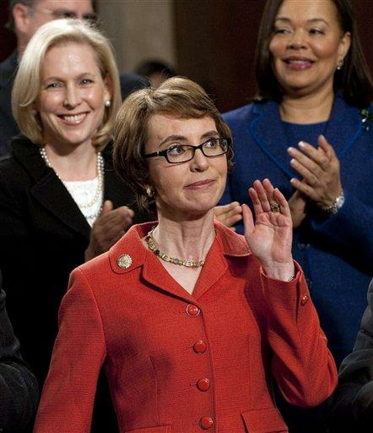 Rep. Gabrielle Giffords, D-Ariz., arrives as members of Congress applaud before President Barack Obama's State of the Union address in front of a joint session of Congress Tuesday at the Capitol in Washington. Associated Press