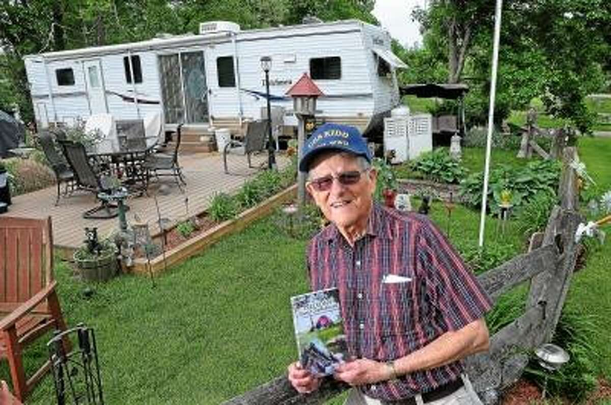 Catherine Avalone/The Middletown Press East Hampton resident Nelson Gustine, 91 year-old author recently wrote