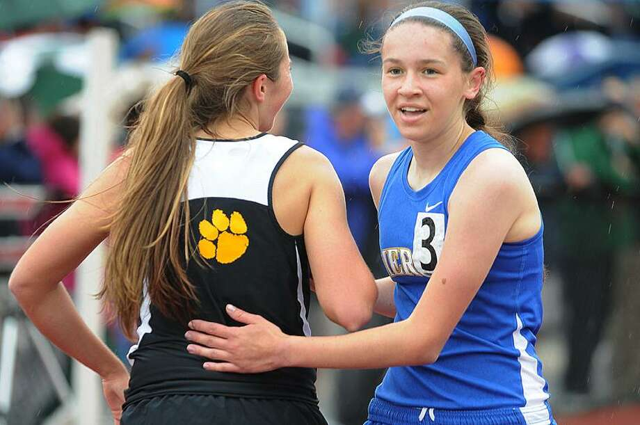 Catherine Avalone/The Middletown PressMercy junior Kaleigh Roberts, of Middletown embraces Hand's Jennifer Hahne after the 1,600-meter run at the Class L state championship meet Tuesday at Middletown High's Rosek-Skubel Stadium. Roberts finished second in the 1600, just ahead of Hahne, and later won the 3200. / TheMiddletownPress
