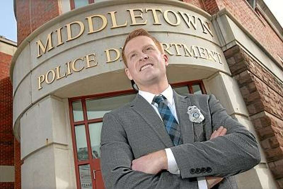 Catherine Avalone/The Middletown Press Granby resident Jason Terribile sworn in as the 110th hire at the Middletown Police Department Friday afternoon. Terribile, originally from Clinton, made a lateral move from the Simsbury Police Department to the Middletown Police Department.
