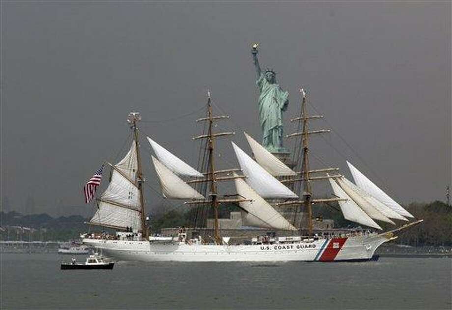 The U.S. Coast Guard Barque Eagle sails by the Statue Of Liberty Wednesday to participate in Fleet Week activities in New York. Associated Press Photo: AP / AP