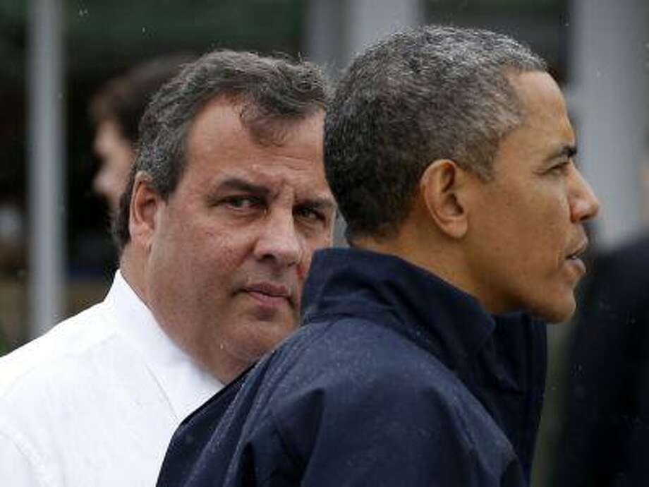 U.S. President Barack Obama and New Jersey Governor Chris Christie look out onto a beach near the boardwalk at Point Pleasant in New Jersey, May 28, 2013. Obama and Christie teamed up again to tour areas damaged by last year's Hurricane Sandy, giving a boost to a Democratic president enmeshed in scandals at home. (Jason Reed/Reuters) Photo: Reuters / X00458