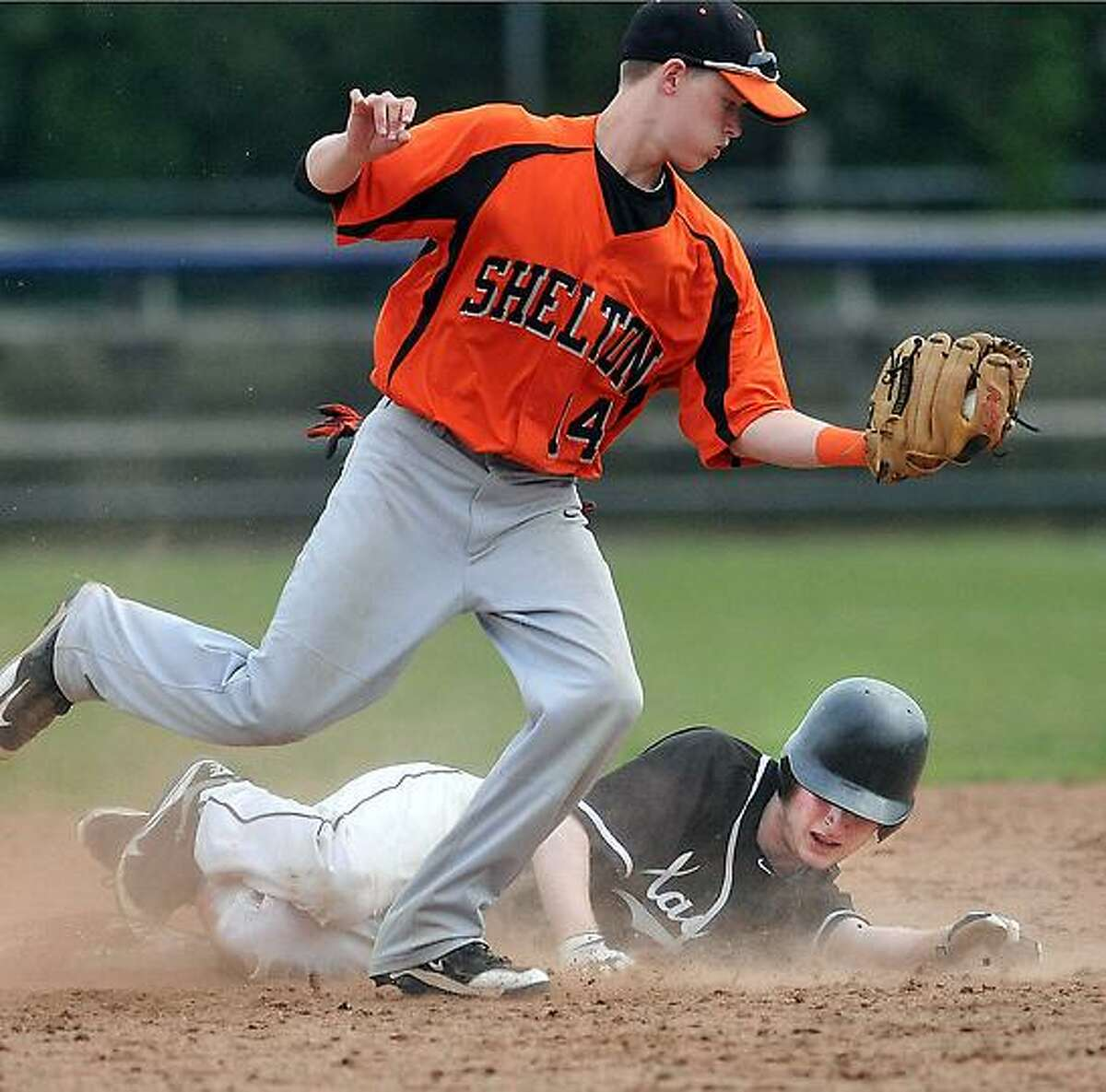 New Haven--SCC semifinal championships. Shelton VS. Xavier. Xavier's Pat Colavecchio slides in safe at second during the 5th inning as Shelton's Ed Groth defends. Peter Casolino/New Haven Register 05/23/12