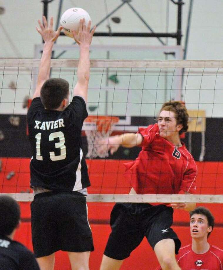 New Haven--SCC championships. Cheshire VS. Xavier Volleyball. Cheshire's Evan Colechia blasts a spike past Xavier's Aidan Marino during the second set.   Peter Casolino/New Haven Register 05/23/12