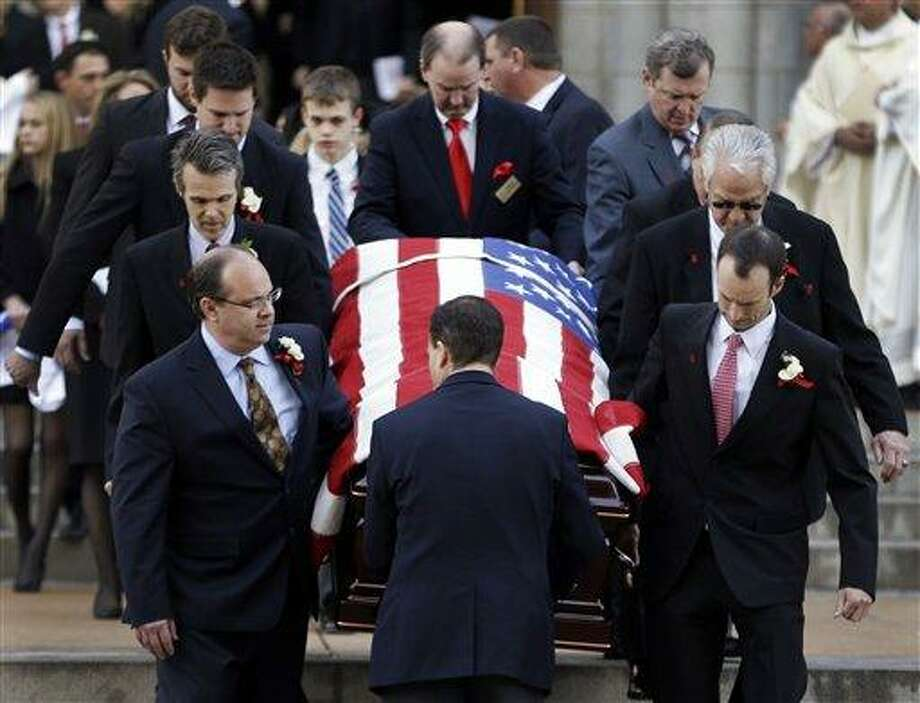 Pallbearers carry the casket containing the body of former St. Louis Cardinals baseball player Stan Musial out of the Cathedral Basilica of Saint Louis following his funeral Mass, Saturday, Jan. 26, 2013, in St. Louis. Musial, one of baseball's greatest hitters and a Hall of Famer with the Cardinals for more than two decades, died Saturday, Jan. 19. He was 92. (AP Photo/Jeff Roberson) Photo: AP / AP