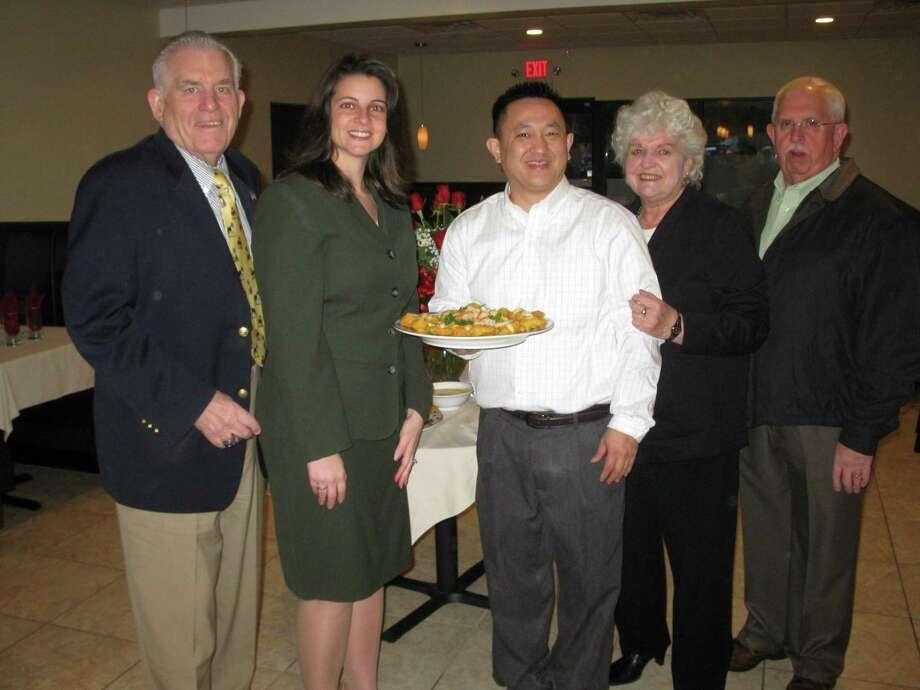 Middlesex Chamber President Larry McHugh, state Rep. Christie Carpino, owner Tai Vuong and Cromwell Selectman Allan Spotts.